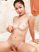 Girlish ladyboy Emma likes the way her sarong hugs the curves of her body. This Pattaya shemale grabs at her bulge to reveal a nice, wet, hard cock!